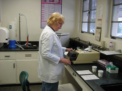 Clinical Laboratory Scientist testing urine samples on the Clinitek automated urine system (see next picture).