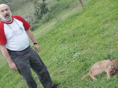 "visit to the Emdoneni Cat Rehab Project--Joel and his ""pet"" kitty"