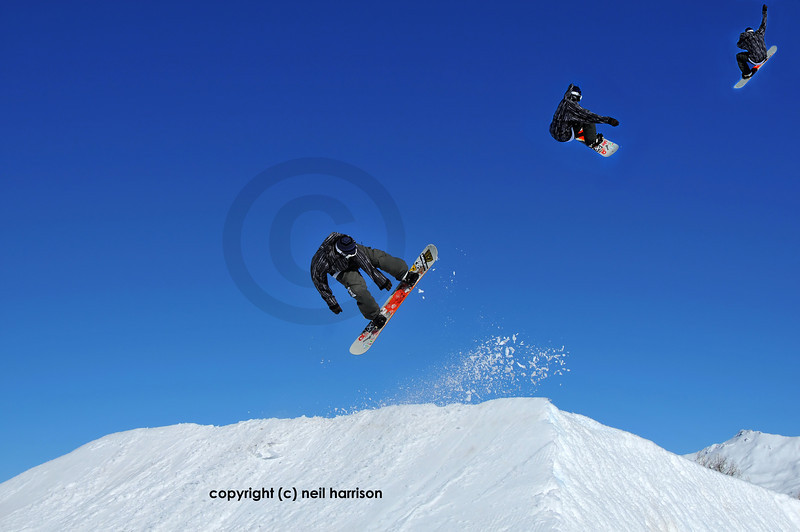 sequence of a snowboarder performing a jump from a snow ramp  and trailing snow behind