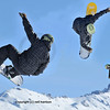 a sequence of 3 shots of a snowboarder performing a jump. The three shots were taken of the same jump, and show snowboarder performing a complete flip in the air, before coming in to land.