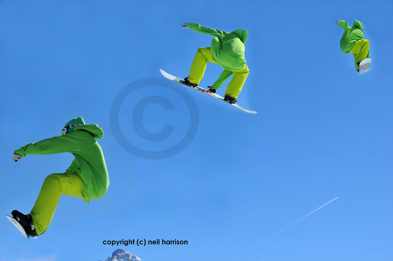 a sequence of a snowboard in lime green clothing jumping.