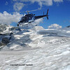 helicopter films low over a sea of glaciers  with the summit of the Matterhorn in the distance.