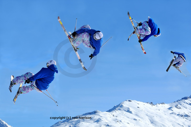 sequence of a skier jumping while crossing his skis and holding both of his skis in his hands and disappearing into the distance