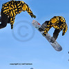 montage of a sequence of shots of a snowboarder performing a jump and turning a full 360 degrees spin.  the shots were taken in the order left to right