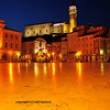 a night scene in a small mediterranean town square. Marble flagstones, venetian houses, and a venetian church in the background