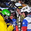 VEYSONNAZ, SWITZERLAND - JANUARY 15:  FIS World Championship Snowboard Cross finals. The womens world champion Helene Olafsen meets mens bronze medalist.  January 15 in Veysonnaz, Switzerland