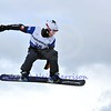 VEYSONNAZ, SWITZERLAND - JANUARY 22: Luca Matteotti (ITA) jumping in the FIS World Championship Snowboard Cross finals : January 22, 2012 in Veysonnaz Switzerland