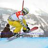 VEYSONNAZ, SWITZERLAND - JANUARY 23: Finalist Daniil Dilman (RUS) jumping at the  FIS World Championship Snowboard Cross finals : January 23, 2012 in Veysonnaz Switzerland