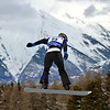 VEYSONNAZ, SWITZERLAND - JANUARY 22: Finalist Alberto Schiavon (ITA) jumping at the FIS World Championship Snowboard Cross finals : January 22, 2012 in Veysonnaz Switzerland
