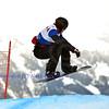 VEYSONNAZ, SWITZERLAND - JANUARY 22: Lluis Marin Tarroch (AND) jumping at the FIS World Championship Snowboard Cross finals : January 22, 2012 in Veysonnaz Switzerland