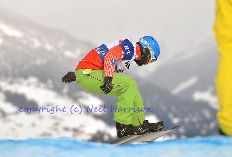 VEYSONNAZ, SWITZERLAND - JANUARY 22:  Finalist Mathew Tunnicliffe (CAN) on a jump at the FIS World Championship Snowboard Cross finals : January 22, 2012 in Veysonnaz Switzerland