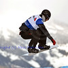VEYSONNAZ, SWITZERLAND - JANUARY 22: Finalist Tony Ramoin (FRA) on a jump at the FIS World Championship Snowboard Cross finals : January 22, 2012 in Veysonnaz Switzerland