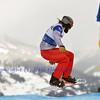 VEYSONNAZ, SWITZERLAND - JANUARY 22: Finalist  Alex Tuttle (USA) jumping at the FIS World Championship Snowboard Cross finals : January 22, 2012 in Veysonnaz Switzerland