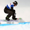 VEYSONNAZ, SWITZERLAND - JANUARY 21: World Champion Nate Hiolland (USA) jumping at the FIS World Championship Snowboard Cross finals : January 21, 2012 in Veysonnaz Switzerland