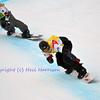 VEYSONNAZ, SWITZERLAND - JANUARY 19: Tony Ramoin (FR) leads Andrey Baldekov (RUS) at the FIS World Championship Snowboard Cross finals : January 19, 2012 in Veysonnaz Switzerland