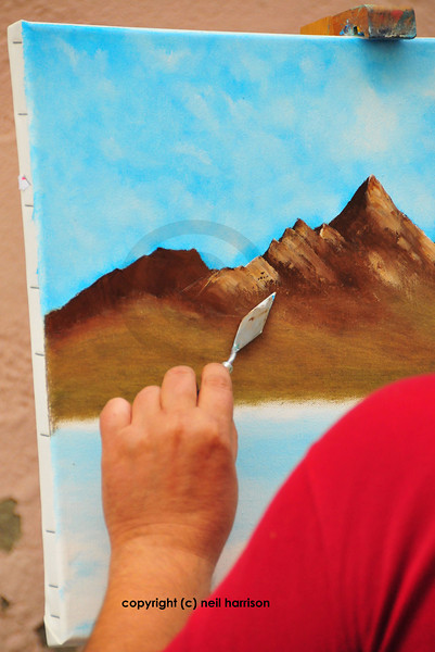 Painting a landscape using a trowel at an art festival in switzerland