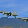 Two F5e tiger fighter aircroaft coming in to land together with mountains in the background