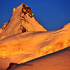 north and West face of Dent d'Herens (4171m) in the Swiss alps at sunset