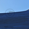 A group of climbers arrive on an ice ridge on the way up to the Tete Blanche in the Swiss Alps.