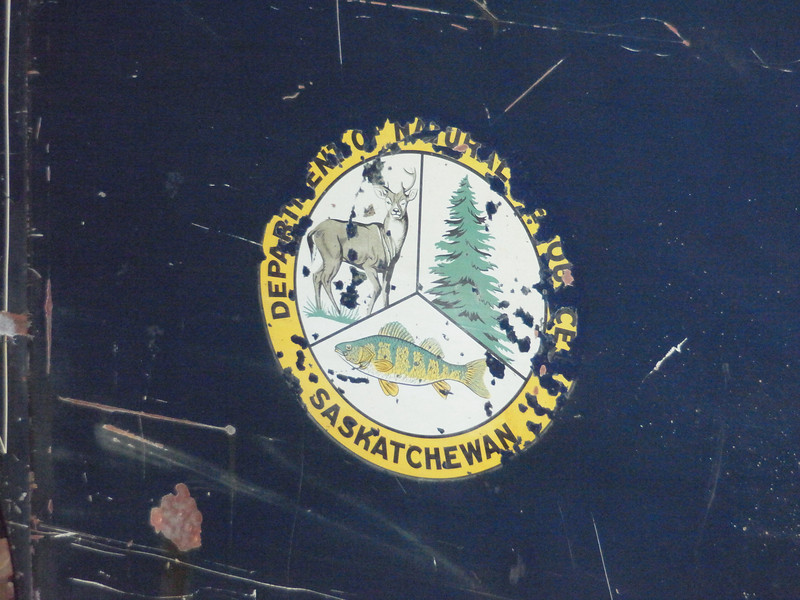Saskatchewan fish + wildlife division logo.