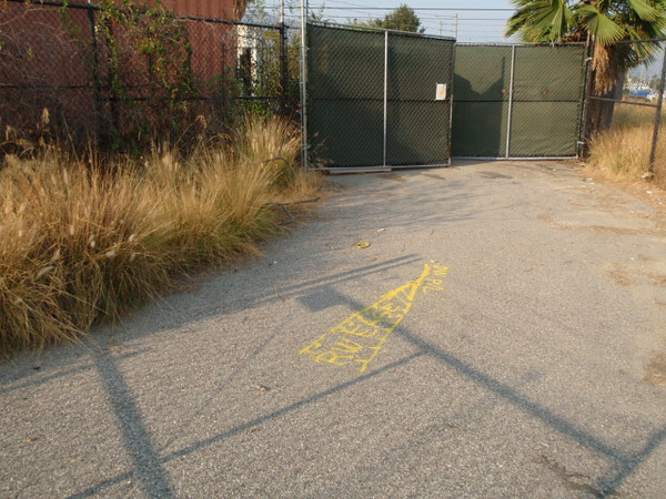 Very Easterly end of Riverwalk easement where it ends on the curving south property line of Dreamworks.  Set Mag Spike&W LS 5573.  Photo is looking east towards gate at east end of cooling equipment building.