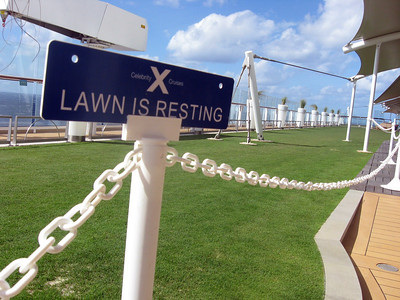 """On the ship's top deck, the lawn (real grass!) """"naps"""" periodically."""