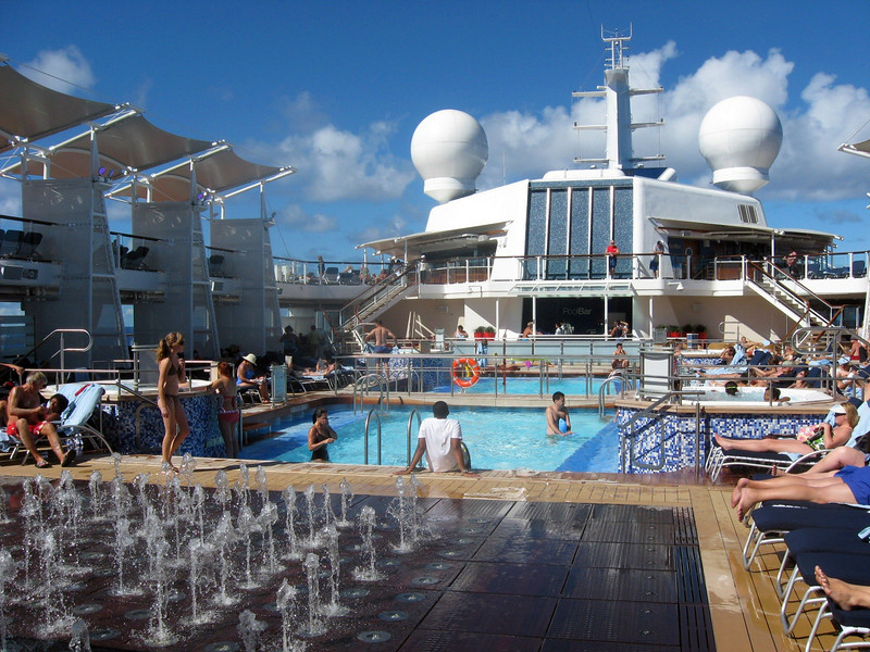 A view of the outdoor pool, spas, and pool bar.