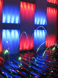 The ship's solarium features a light show with light tubes surrounded by jets of water.