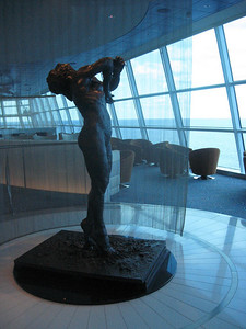 "In the ship's ""Sky Observation Lounge,"" this nude on tip-toe greets cruisers."