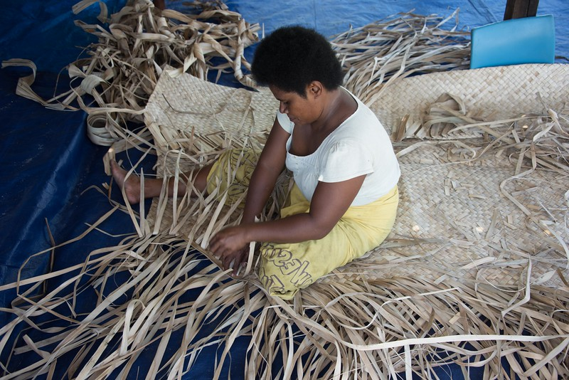 Weaving floor mats, Navotua Village