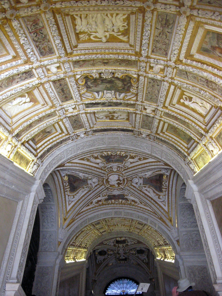 "The lavish ""Scala d'Oro"" built between 1554 and 1558 with an arched ceiling embellished with gilded stucco."