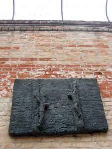 Bas relief memorials to the Holocaust--note the barbed wire at top.