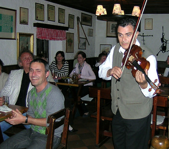 The Wiener Heurigen Show at the Wine Tavern Wolff - my colleague, Jorge Diaz-Cintaz of Roehampton University in London, claps along