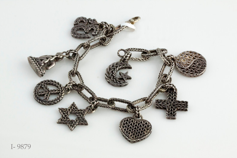 #0001  $450.00 Sterling Silver John Hardy Charm Bracelet.