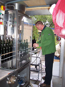 Another view of Ronald and the bottling line.