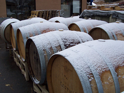 The first snow of '06 frosts empty barrels outside the winery.