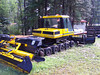 A snowcat with the tracks off for summer maintenance.
