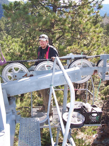 Fifty feet up... Sipapu GM, John Paul, does annual pre-season maintenance on lift #1.