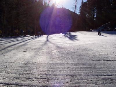Fresh groomed snow in the morning sun.
