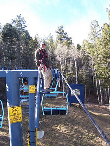 Top of the mountain... Chris does annual pre-season maintenance on lift #4.
