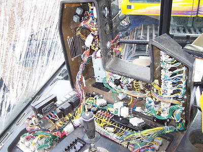 The wiring nightmare underneath the cockpit of the Bombardier  Snowcat.