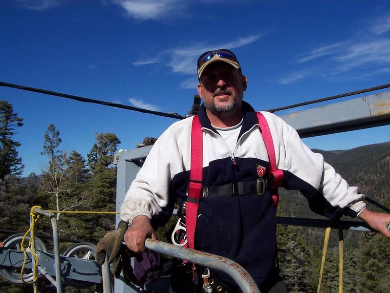 Fifty feet up... Chris does annual pre-season maintenance on lift #1.