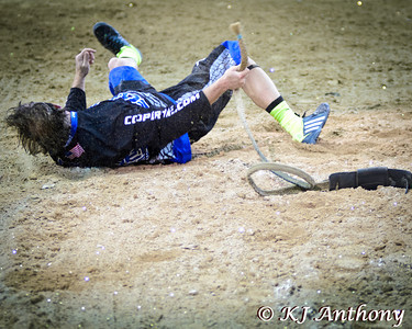 Flint Rasmussen fights an 'Australian bull snake' at the 2013 PBR Built Ford Tough World Finals in Las Vegas.