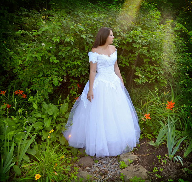 Fairytale wedding outdoor bride photography and nature Wedding Photographer in Syracuse New York. Professional Wedding Photography in the Forest and Magical Woods by Mariana Roberts Wedding Photography. Wedding Photographic Art by Mariana Roberts and Artistic, Magical, Fantasy and Surreal Wedding Photographer. Creative Wedding portraits by Mariana Roberts Photography of Syracuse and Liverpool New York.