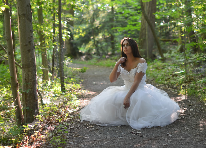 Outdoor nature bridal Photography Syracuse New York. High Fashion Bridal Photography New York. Bridal Portraits in the Forest by Mariana Roberts. Fairytale Bride Portraits in the Beautiful Forest Trees of Nature. Artistic Bridal Nature Photographer serving Syracuse NY, Central NY and Upstate NY. Wedding Bridal Photography and Fine Art Bridal Photography. Photography by Mariana Roberts serving Central NY and the Upstate NY Region. Artistic and Fine Art Wedding Photography by Mariana Roberts. Pictures of a Bride in the Forest. Outdoor Nature Wedding Photography. Mariana Roberts is Available for Destination Weddings in the United States. Wedding Photography Studio in Liverpool NY. Please call us at (315) 409-6893 to book your event or E-mail us at MarianaRobertsPhotography@gmail.com