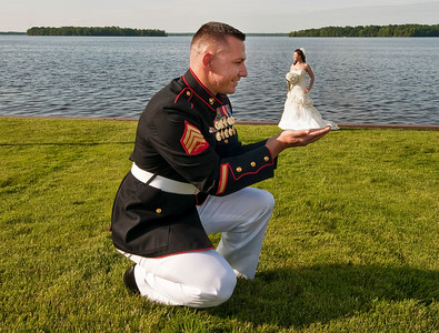 Groom Holding Bride in the Palm of his hands.