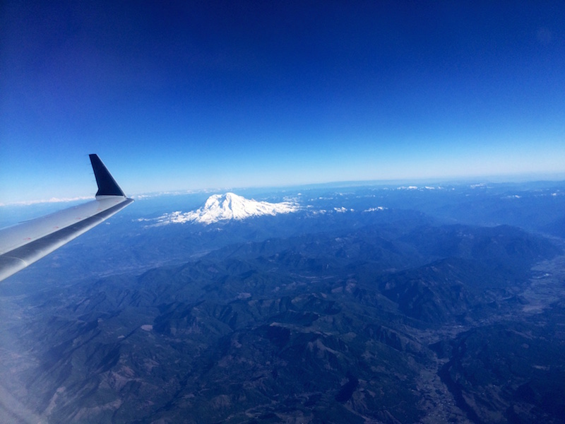 photo of airplane wing and Mt. Rainier outside Seattle, Washington