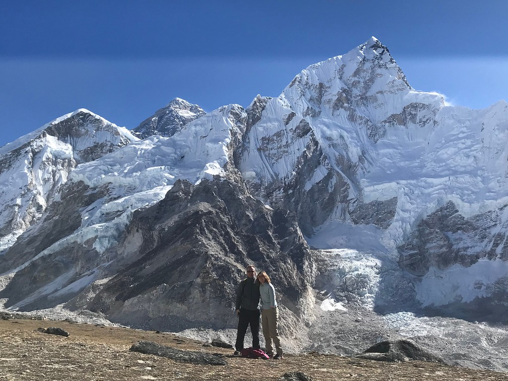 Brittany Palmer of Beeyonder and her husband stand in front of Mt. Everest in Nepal