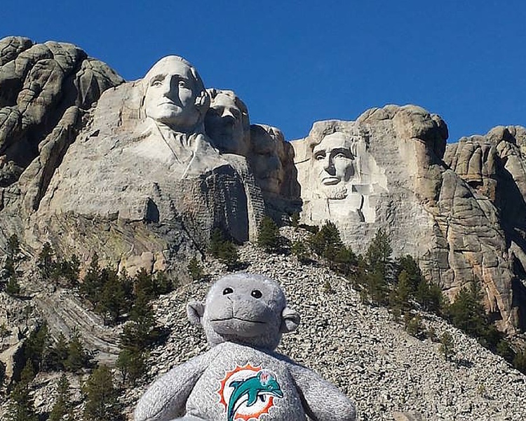 Vicky Sosa and Buddy the Traveling Monkey at Mt. Rushmore