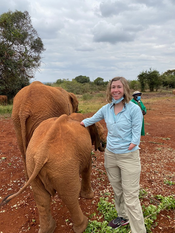 Brittany Palmer, founder of travel start up Beeyonder, with baby elephants in Nairobi, Kenya